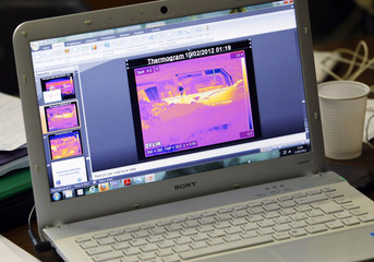 A thermogram image of the capsized Costa Concordia cruise ship is displayed on a laptop at the Department of Earth Sciences of the University of Florence at Giglio island
