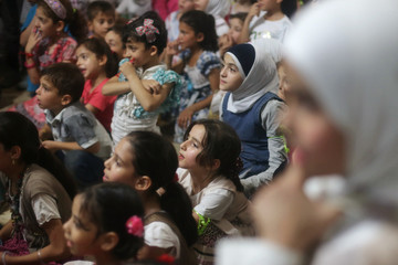 Children take part in celebrations marking World Children?s Day in Syria, in the eastern Ghouta of Damascus
