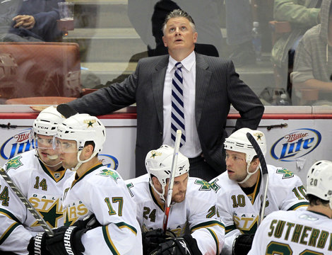 Dallas Star's head coach Crawford looks up at the scoreboard in the first period of his team's NHL hockey game against the Anaheim Ducks in Anaheim