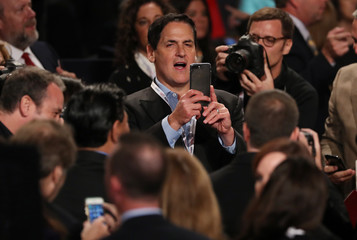 Cuban takes a picture in the crowd as he awaits the start of Trump and Clinton's third and final 2016 presidential campaign debate at UNLV in Las Vegas