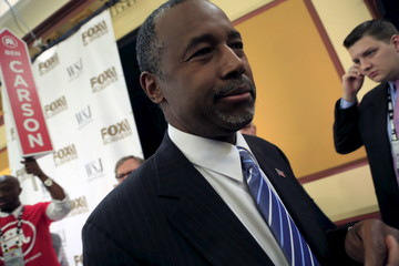 Republican Presidential candidates Ben Carson takes questions from the media in the spin room after the debate held by Fox Business Network for the top 2016 U.S. Republican candidates
