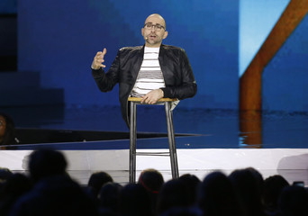 Motivational speaker Spencer West, who had both of his legs amputated when he was five years old due to a genetic disorder, speaks during We Day California in Inglewood
