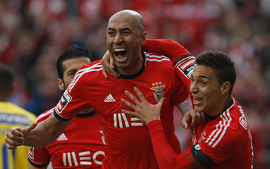 Benfica's Luisao celebrates his goal against Estoril with teammate Machado during their Portuguese premier league soccer match in Lisbon