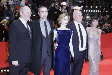 "Cast members pose on the red carpet to promote the movie ""Bel Ami"" at the Berlinale International Film Festival in Berlin"