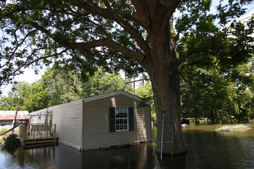 A home is seen partially submerged as floodwaters approach Simmesport, Louisiana