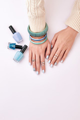 Fototapete - Blue manicure and correctly selected bijouterie.