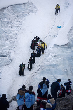 """Ukukus"" or protectors of the Lord ""Qoyllur Rit'i"" descend from a glacier with a cross during celebrations in honor of the Lord at the Sinakara Valley in Cuzco"