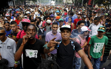 Protesters smoke marijuana during a demonstration in support of the legalization of marijuana in Medellin