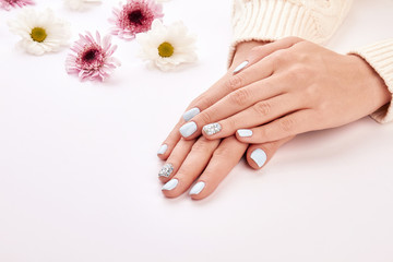 Fototapete - Delicate woman's manicure on a white background.