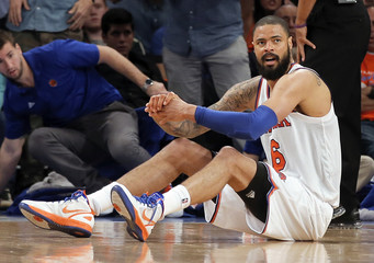 Knicks' Chandler sits on the court after he chased a loose ball and committed a foul against the Pacers during Game 1 of their NBA Eastern Conference Semifinals basketball playoff series in New York