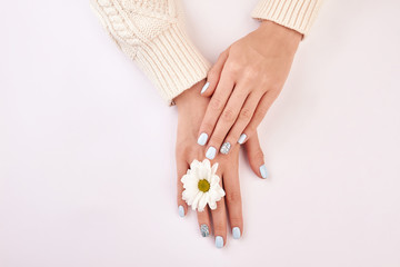 Fototapete - Delicate female hands with a white chrysanthemum.
