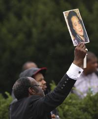 A preacher displays a picture of Coretta Scott King at the Lincoln Memorial in Washington