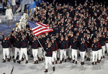 Luger Mark Grimmette of the United States leads his delegation during the opening ceremony of the Vancouver 2010 Winter Olympics.