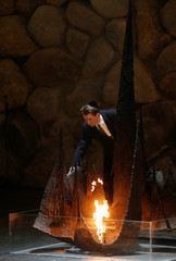 Austrian Foreign Minister Sebastian Kurz rekindles the eternal flame, commemorating the six million Jews killed by the Nazis in the Holocaust, during a ceremony in the Hall of Remembrance at the Yad Vashem Holocaust memorial in Jerusalem