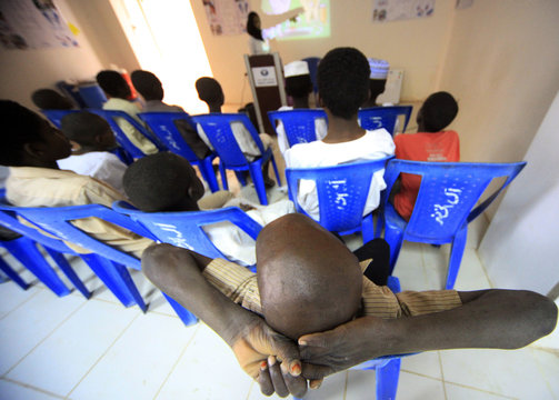 Children from Khalwas (Koran school) of the Jabel Awlia district attend lectures on oral hygiene in Khartoum