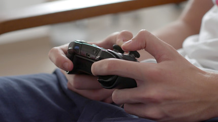 Close up of boy hands using game controller, in the end throwing the controller, angry close up