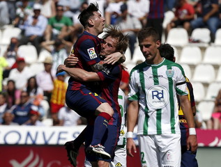 Barcelona's Ivan Rakitic celebrates a goal with team mate Lionel Messi during their Spanish first division soccer match at El Arcangel stadium in Cordoba