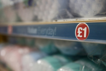 A sign is seen in a Poundland store in London