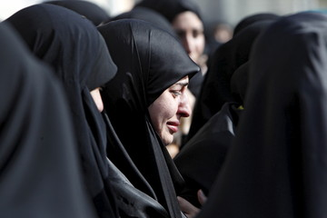 Women mourn the death of Hezbollah fighter Adnan Siblini, who was killed while fighting against insurgents in the Qalamoun region, during his funeral in al-Ghaziyeh village, southern Lebanon