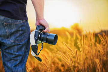 Close-up shot of man hand holding camera.