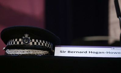 Metropolitan Police Commissioner, Bernard Hogan-Howe's hat sits on a table as he delivers his final speech, at the Royal United Services Institute (RUSI), in London