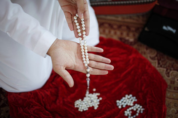 An Emirate man displays rosaries made from pearls at RAK's oyster farm off the coast of Ras Al Kaimah, one of the seven emirates that make up the United Arab Emirates