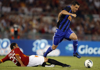 Slovan Bratislava's Kladrubsky fights for the ball with AS Roma's Perrotta during their Europa League soccer match in Rome