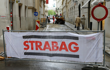 The logo of Austrian construction firm Strabag is seen on the fence blocking a road in Vienna