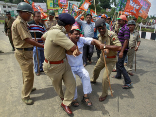 A supporter of India's main opposition BJP shouts slogans as he is detained by police during a 12-hour strike in Agartala
