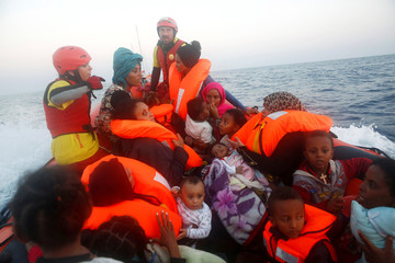 Migrants from Eritrea are seen onboard a rescue boat of the Spanish NGO Proactiva, off the Libyan coast in Mediterranean Se