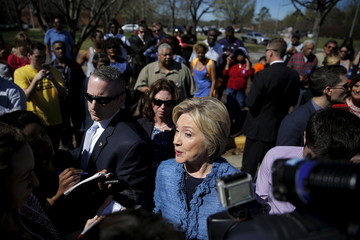Democratic U.S. Presidential candidate Hillary Clinton talks to reporters during campaign stop outside of a polling station in Raleigh, North Carolina