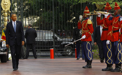 U.S. President Obama is greeted by the honor guard at the Presidential Palace in Dakar, Sengal