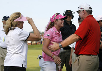 Paula Creamer of the U.S. celebrates on the 18th green with her parents Paul and Karen after winning the Women's U.S. Open Golf Championship in Oakmont