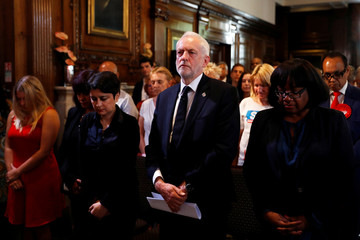 Jeremy Corbyn, the leader of Britain's opposition Labour party, observes a minute's silence for the victims of the attack on the Manchester Arena, before making a speech as his party restarts its election campaign in London