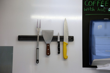 Knives and other cooking utensils are seen in a snack van along the A413 near Aylesbury