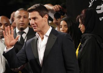 U.S. actor Tom Cruise waves as he arrives for the 8th Dubai International Film Festival