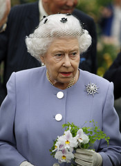 Britain's Queen Elizabeth holds a posy of flowers during a visit to the Chelsea Flower Show on press day in London