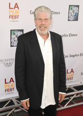 """Cast member actor Ron Perlman arrives at the """"Don't Be Afraid of the Dark"""" premiere during the Los Angeles Film Festival in Los Angeles, California"""