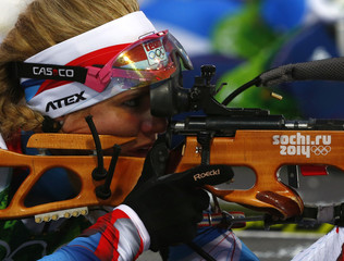 Soukalova of the Czech Republic aims during the mixed biathlon relay at the 2014 Sochi Winter Olympics in Rosa Khutor