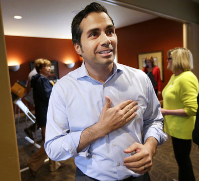 """Independent U.S. Senate candidate Greg Orman places his """"I Voted"""" sticker on his shirt after voting near his home, in the U.S. midterm elections in Olathe"""