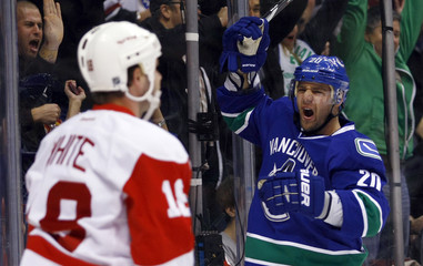 Vancouver Canucks Chris Higgins celebrates his goal against the Detroit Red Wings during the first period of their NHL game in Vancouver.