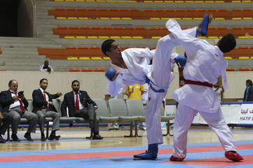 Doisy kicks Tahir during their Under-21, under 68kg category gold medal match at the 22nd Karate Championship in Benghazi