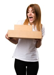 Surprised Beautiful young girl holding boxes