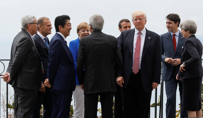 U.S. President Trump gathers with other G7 leaders as they attend the G7 Summit in Taormina