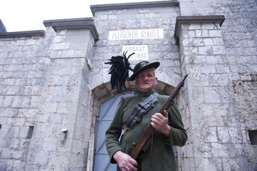 """A member of the society """"1313"""", dressed in uniform from the First World War, performs in the fortress of Kluze"""