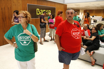 Members of the Mortgage Victims' Platform occupy Bankia's central branch in Valencia