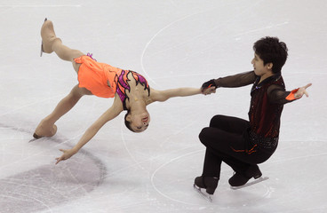 Sui Wenjing and Han Cong of China perform in the pairs short program at the ISU World Figure Skating Championships in London