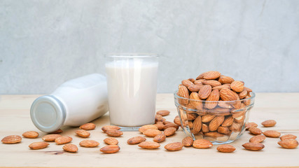 Almond milk on a wooden table.