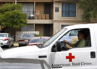 A Red Cross worker leaves after delivering food to the apartment unit in The Ivy Apartments where a man diagnosed with the Ebola virus was staying in Dallas