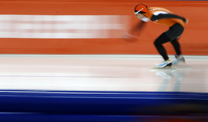Koen Verweij of the Netherlands competes in the men's 1,500 metres speed skating competition at the 2014 Sochi Winter Olympics